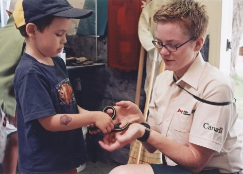Sharing a moment with Guillaume and a garter snake at St. Lawrence Islands National Park
