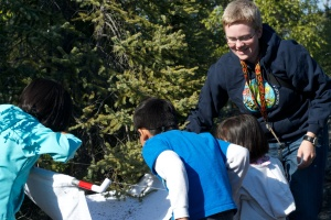 "Inspecting the contents of a beat sheet with local children during a ""BugFest"" event at the Yellowknife Heritage Museum"